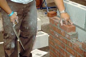mason training laying brick